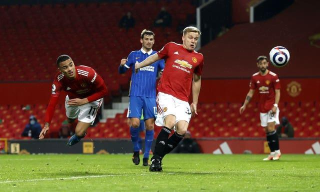 Mason Greenwood, left, scores Manchester United's winner