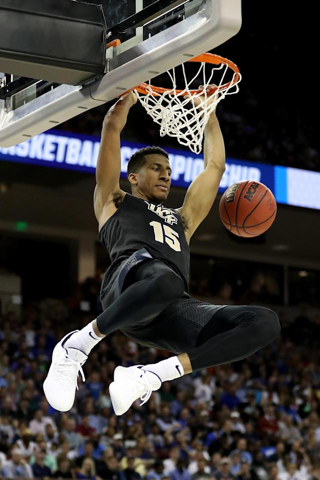 <p>Aubrey Dawkins #15 of the UCF Knights dunks the ball against the Duke Blue Devils during the second half in the second round game of the 2019 NCAA Men's Basketball Tournament at Colonial Life Arena on March 24, 2019 in Columbia, South Carolina. (Photo by Streeter Lecka/Getty Images) </p>