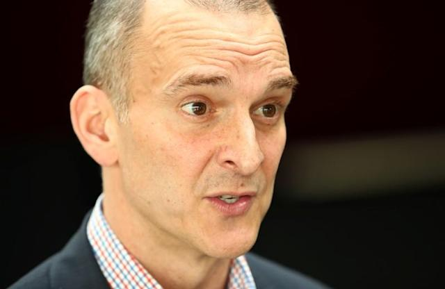 USDA CEO Tygart attends an interview with Reuters during the WADA Symposium in Ecublens