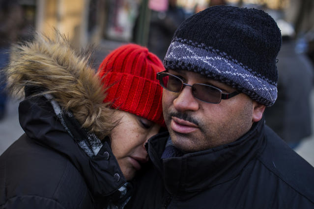 <p>Betty Rodriguez and her husband Joel Rodriguez, residents of the building where a dozen people died in a fire on Thursday, react as they talk to the media on Friday, Dec. 29, 2017, in the Bronx, New York. (Photo: Andres Kudacki/AP) </p>