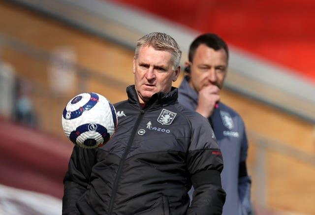 Aston Villa manager Dean Smith, left, took encouragement from the defeat to Liverpool