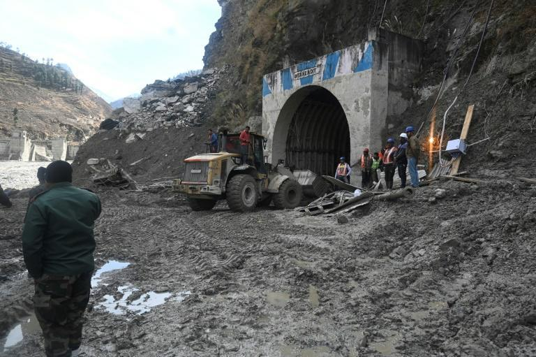 Hundreds of workers toiled all night and by morning had cleared their way 120 metres into the tunnel