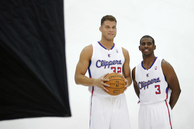 Los Angeles Clippers' Blake Griffin and Chris Paul, right, pose for photos during the team's NBA basketball media day on Monday, Sept. 30, 2013, in Los Angeles. (AP Photo/Jae C. Hong)