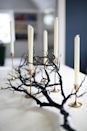 """<p>Blogger Emily Schuman nabbed this candlestick branch from Crate and Barrel, then placed gold candlesticks in-between its branches to create a gothic-style centerpiece. </p><p><strong>Get the tutorial at <a href=""""http://cupcakesandcashmere.com/decor/halloween-house-moments"""" rel=""""nofollow noopener"""" target=""""_blank"""" data-ylk=""""slk:Cupcakes and Cashmere"""" class=""""link rapid-noclick-resp"""">Cupcakes and Cashmere</a>. </strong></p><p><strong><a class=""""link rapid-noclick-resp"""" href=""""https://www.amazon.com/Nuptio-Candlestick-Decorative-Centerpiece-Housewarming/dp/B07W554ZNB/ref=sr_1_22?tag=syn-yahoo-20&ascsubtag=%5Bartid%7C10050.g.3739%5Bsrc%7Cyahoo-us"""" rel=""""nofollow noopener"""" target=""""_blank"""" data-ylk=""""slk:SHOP GOLD CANDLESTICKS"""">SHOP GOLD CANDLESTICKS</a><br></strong></p>"""