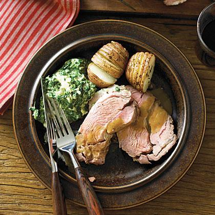 """<p>Slather the meat with an aromatic herb and garlic oil, then roast with lots more garlic to season the velvety <a href=""""https://www.myrecipes.com/holidays-and-occasions/thanksgiving-recipes/turkey-gravy-recipes"""" rel=""""nofollow noopener"""" target=""""_blank"""" data-ylk=""""slk:pan gravy"""" class=""""link rapid-noclick-resp"""">pan gravy</a>.</p>"""