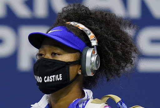 Naomi Osaka, of Japan, walks on the court before playing Jennifer Brady, of the United States, during a semifinal match of the US Open tennis championships, Thursday, Sept. 10, 2020, in New York. (AP Photo/Seth Wenig)