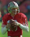 FILE PHOTO: San Francisco 49ers quaterback Joe Montana smiles as he warms up for the first time in two seasons before the game against Tampa Bay at Candlestick Park