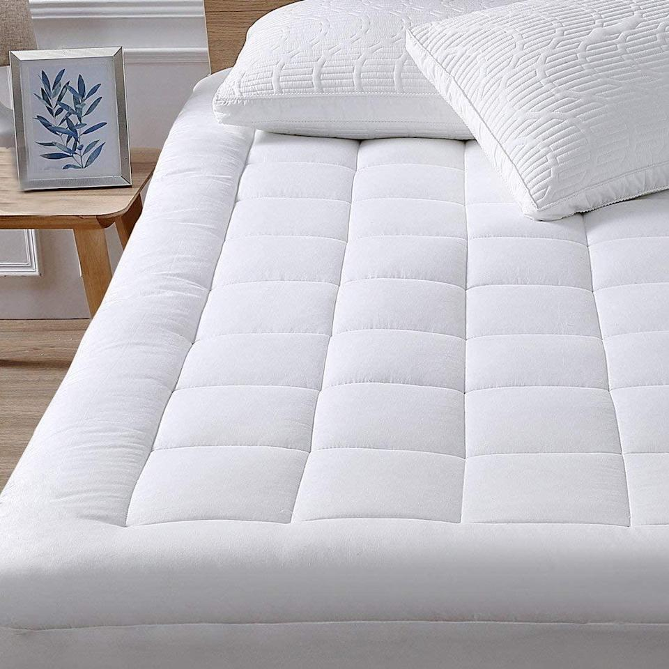 "<h3>And Lastly, Bedding...</h3><br><h2>33% Off Oaskys Cooling Cotton Mattress Pad Topper</h2><br>Upgrade your sleep space with this cooling mattress pad that's crafted from an ultra-soft 100%-cotton cover and breathable down-alternative fill. <br><br><br><strong>Oaskys</strong> Cooling Cotton Mattress Pad Topper, $, available at <a href=""https://amzn.to/2VkcC8s"" rel=""nofollow noopener"" target=""_blank"" data-ylk=""slk:Amazon"" class=""link rapid-noclick-resp"">Amazon</a>"