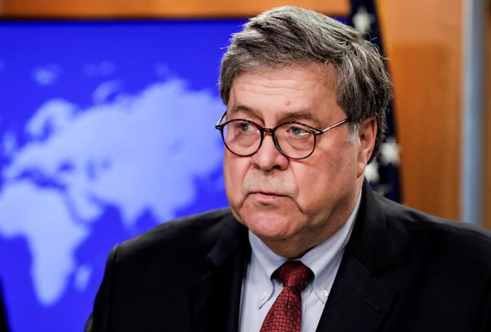 FILE PHOTO - U.S. Attorney General William Barr discusses a Trump administration executive order on the International Criminal Court during a joint news conference at the State Department in Washington, U.S., June 11, 2020. REUTERS/Yuri Gripas/Pool