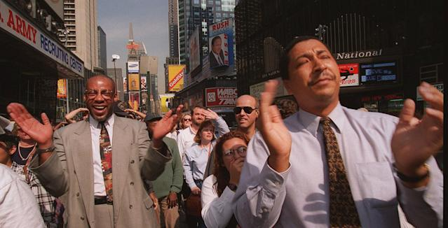 <p>Part of a crowd of pedestrians react as they watch the Jumbotron television screen in New York's Times Square, Oct. 3, 1995, and the news that O.J. Simpson was found not guilty of killing Nicole Brown Simpson and Ronald Goldman. (Photo: Rosario Esposito/AP) </p>
