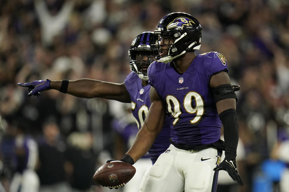 Baltimore Ravens linebacker Odafe Oweh celebrates after recovering a Kansas City Chiefs fumble in the second half of an NFL football game, Sunday, Sept. 19, 2021, in Baltimore. Baltimore won 36-35. (AP Photo/Julio Cortez)