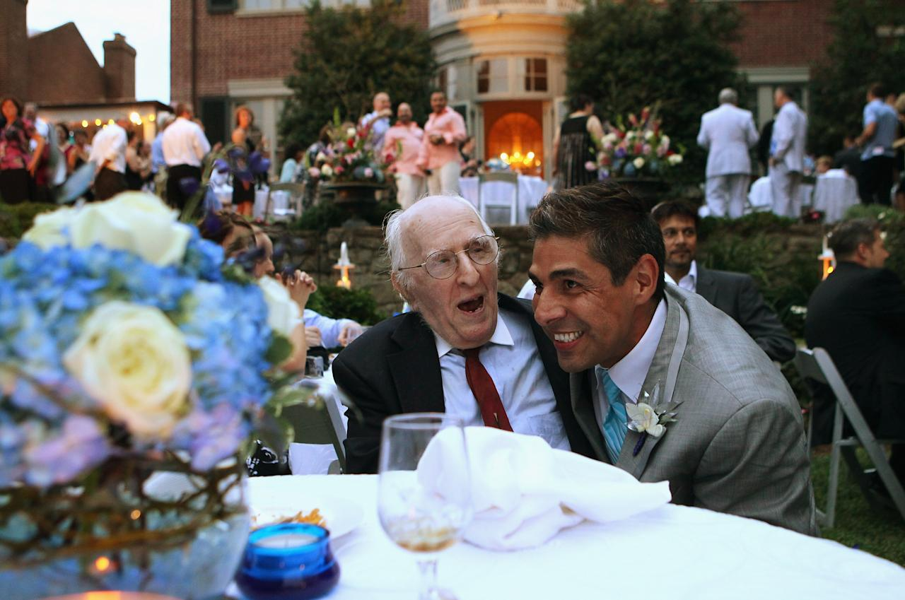 WASHINGTON - AUGUST 21: TV reporter Roby Chavez (R) shares a moment with gay rights activist Frank Kameny (L) during Chavez's wedding ceremony with Chris Roe (R) August 21, 2010 at the Woodrow Wilson House in Washington, DC. Chavez of Matthews, Louisiana, and Roe, of Monticello, Wisconsin, tied the knot after they have been together for five years. Roe popped the question on the night when DC became the sixth place in the U.S. to legalize same-sex marriage while Chavez was on a tight deadline covering the story. The couple will spend two weeks in Greece for their honeymoon. (Photo by Alex Wong/Getty Images)