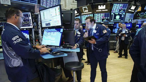 PHOTO: Traders and financial professionals work on the floor of the New York Stock Exchange at the opening bell on August 15, 2019, in New York. (Drew Angerer/Getty Images)