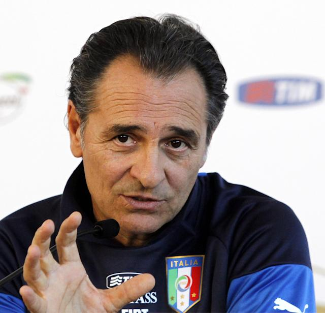 Italy coach Cesare Prandelli speaks during a press conference at the national team's Coverciano training complex in Florence, Italy, Tuesday, April 15, 2014, where 42 players were called up for World Cup fitness tests. (AP Photo/Fabrizio Giovannozzi)
