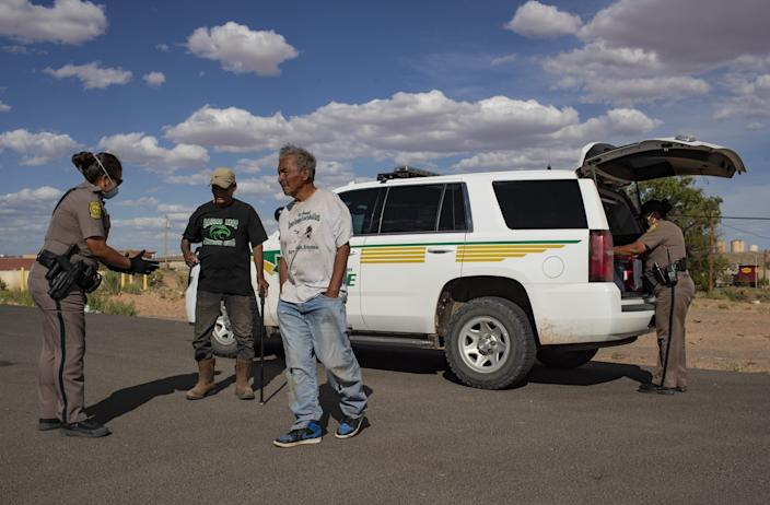 Navajo Nation police officers stop two men in Tuba City