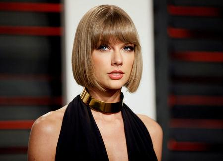 FILE PHOTO: Singer Taylor Swift arrives at the Vanity Fair Oscar Party in Beverly Hills
