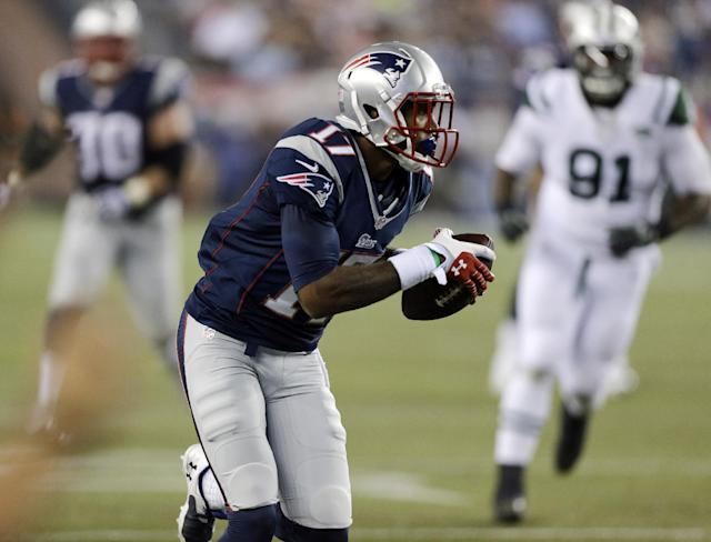New England Patriots wide receiver Aaron Dobson (17) catches a pass in front of New York Jets defensive end Sheldon Richardson (91) and heads for the goal with a first-quarter touchdown in an NFL football game Thursday, Sept. 12, 2013, in Foxborough, Mass. (AP Photo/Charles Krupa)