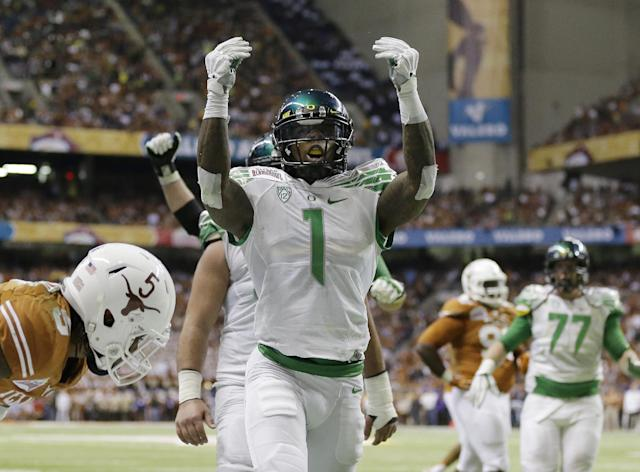 Oregon's Josh Huff (1) celebrates after scoring a touchdown against Texas during the second quarter of the Valero Alamo Bowl NCAA college football game, Monday, Dec. 30, 2013, in San Antonio. (AP Photo/Eric Gay)