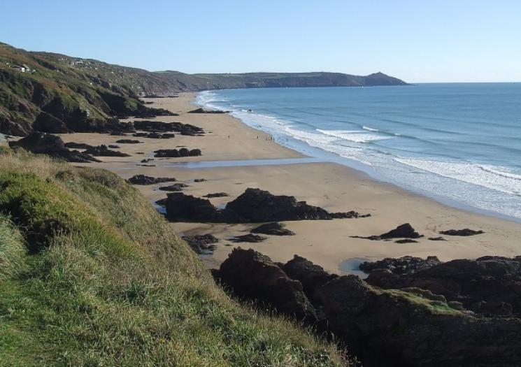 <p>Reachable only by steep, rocky paths, Whitsand Bay is a hidden oasis in south-east Cornwall. The rarely crowded three-mile stretch of beach is great for long scenic walks and jogs along the shore. An ex-naval frigate sunk in 2004 to form an artificial reef that makes for a popular dive site.</p><p><strong>Don't Miss</strong>: Lugger's Cave, a grotto excavated by hand in the late 18th-century by a reclusive sailor who spent his time inscribing verses on the grotto ceiling.</p>