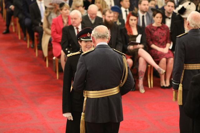 The Prince of Wales presents Major Wetherill with her MBE
