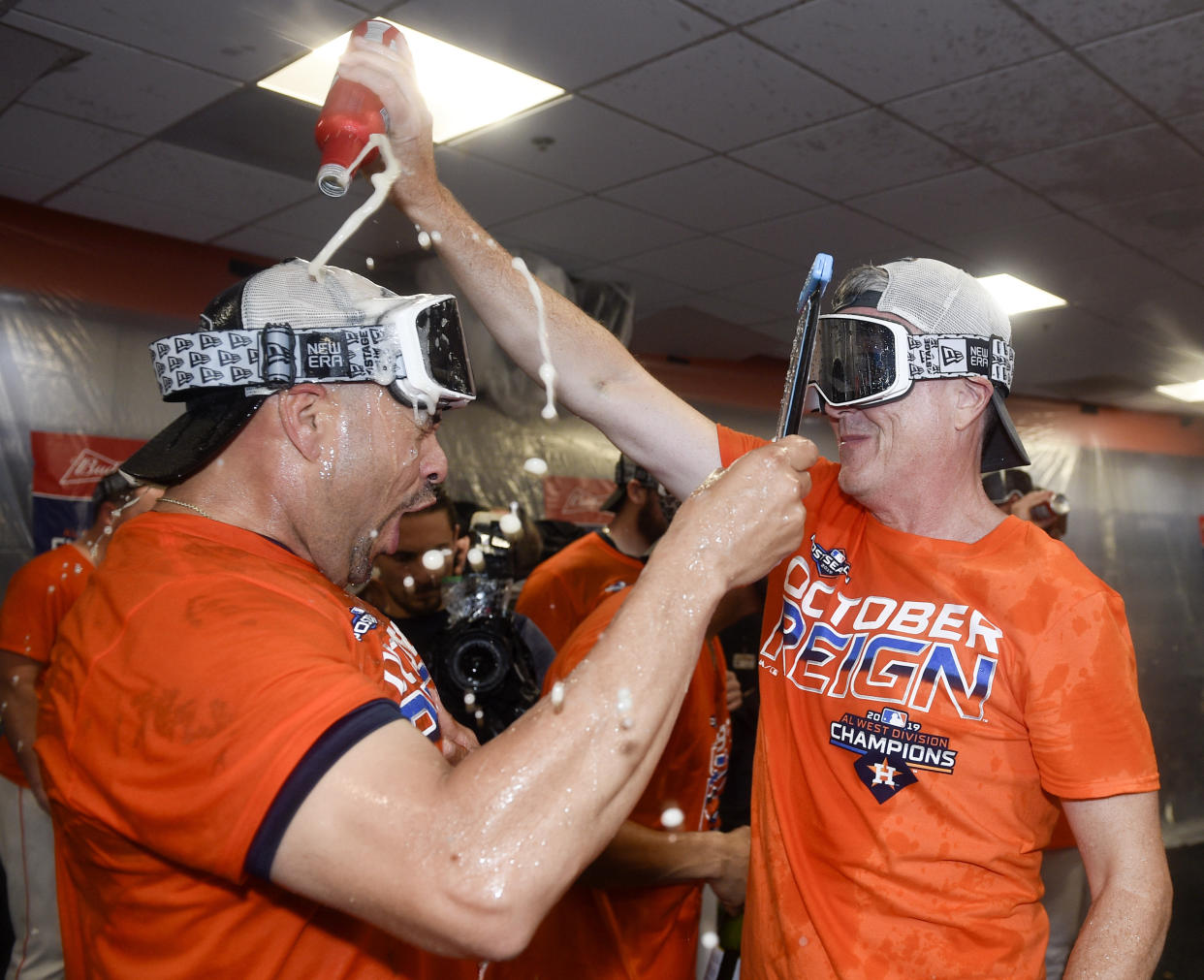 Houston Astros' general manager Jeff Luhnow, right, celebrates the team's clinching of the AL West crown with Javier Bracamonte after a baseball game against the Los Angeles Angels, Sunday, Sept. 22, 2019, in Houston. (AP Photo/Eric Christian Smith)