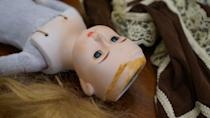 <p>Remove all fabric, hair, and the top part of the scalp, then detach the head from the body. You may need fabric scissors for this, as some parts may be sewn and others are glued.</p>