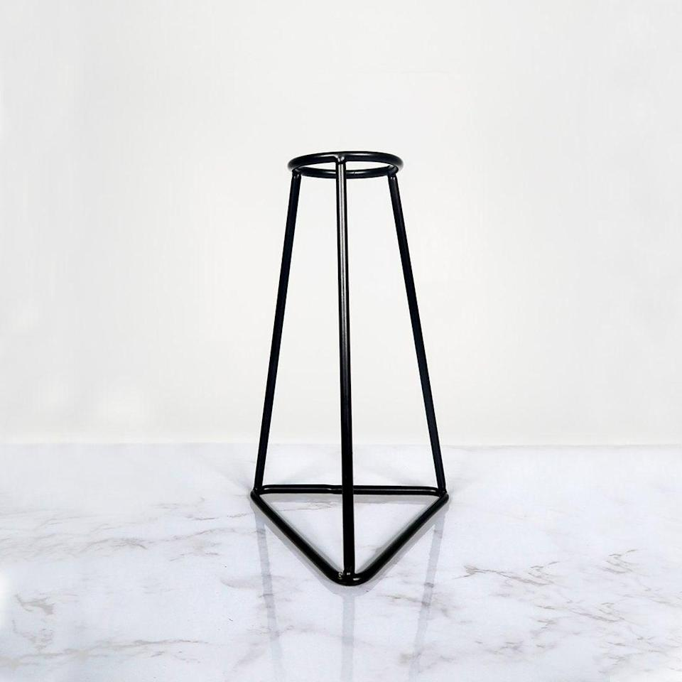 """Another from the eponymous Silhouette Vases but in a squatter, more diamond-shaped style.<br><br><strong>Silhouette Vases</strong> Silhouette Vase™️ – F, $, available at <a href=""""https://silhouettevases.com/products/brand-new-style-retro-iron-line-flowers-vase-metal-plant-holder-modern-solid-home-decor-nordic-styles-iron-vase?variant=37816914444476"""" rel=""""nofollow noopener"""" target=""""_blank"""" data-ylk=""""slk:Silhouette Vases"""" class=""""link rapid-noclick-resp"""">Silhouette Vases</a>"""