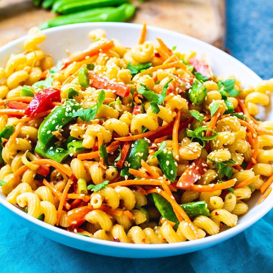 """<p>Refreshing and flavorful, this Asian salad has notes of sesame and soy dressing that make it almost too good to be true. If you want to take this recipe to the next level, pair it with freshly grilled chicken breast or roasted tofu. We suggest making a big batch because it tastes even better the next day.</p> <p><strong>Get the recipe:</strong> <a href=""""https://spicysouthernkitchen.com/asian-pasta-salad/"""" class=""""link rapid-noclick-resp"""" rel=""""nofollow noopener"""" target=""""_blank"""" data-ylk=""""slk:Asian pasta salad"""">Asian pasta salad</a></p>"""