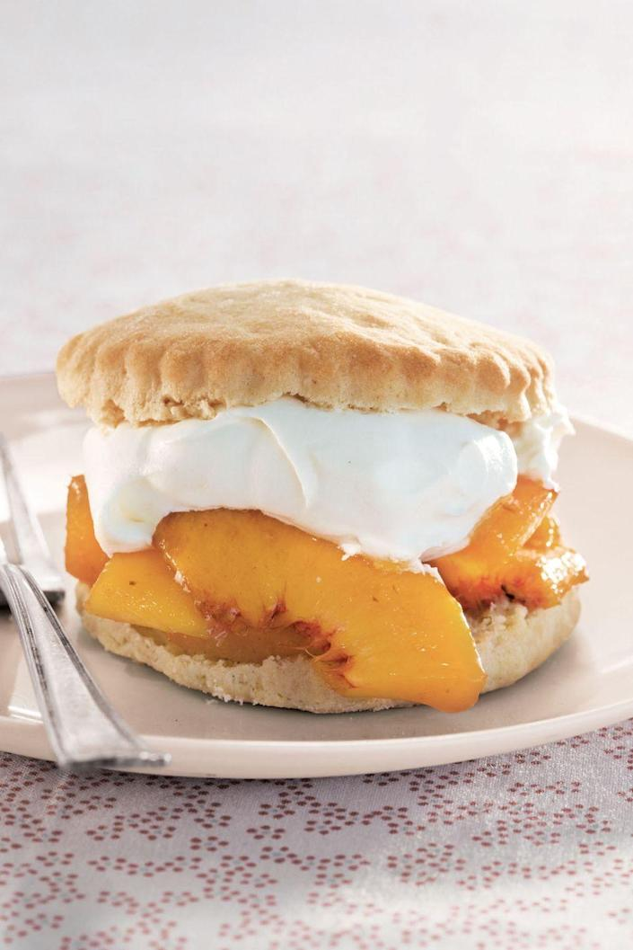 "<p>This delightful dessert features peaches covered in homemade whipped cream and sandwiched between two fluffy, golden biscuits. </p><p><a href=""https://www.womansday.com/food-recipes/food-drinks/recipes/a39494/peach-shortcakes-recipe-clv0613/"" rel=""nofollow noopener"" target=""_blank"" data-ylk=""slk:Get the recipe."" class=""link rapid-noclick-resp""><strong>Get the recipe.</strong></a><br></p>"