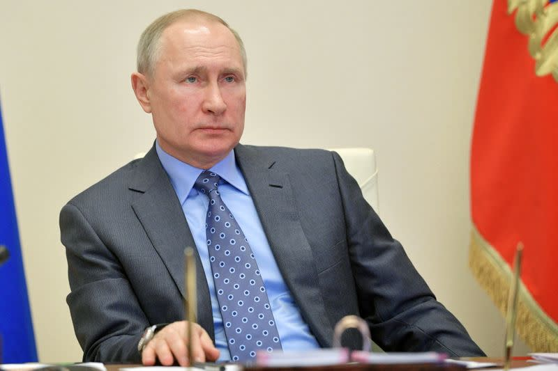 Russian President VladimirPutin chairs a meeting with members of the government outside Moscow