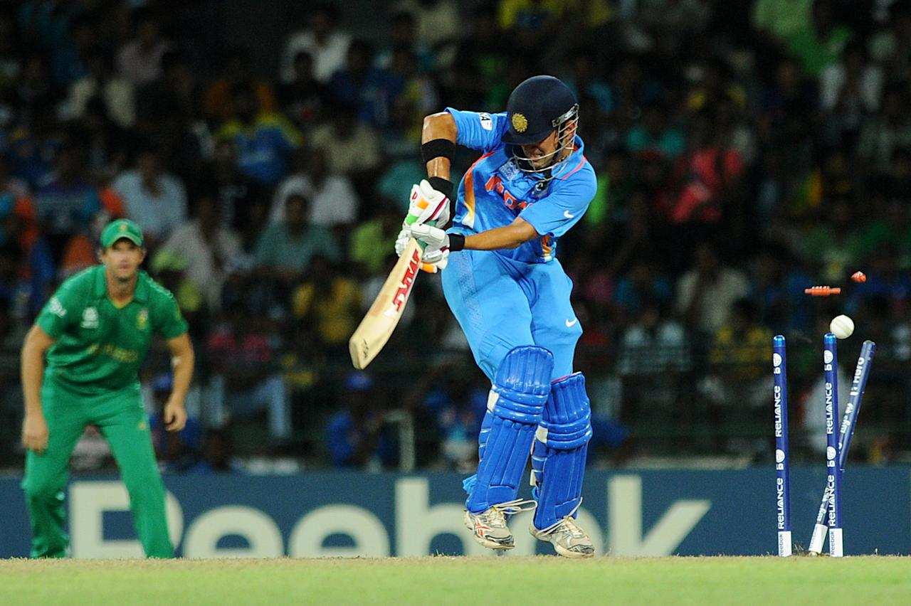 Indian cricketer Gautam Gambhir is bowled out by South Africa cricketer Morne Morkel during the ICC Twenty20 Cricket World Cup's Super Eight match between India and South Africa at the R.Premadasa International Cricket Stadium in Colombo on October 2, 2012. AFP PHOTO /Ishara S.KODIKARA