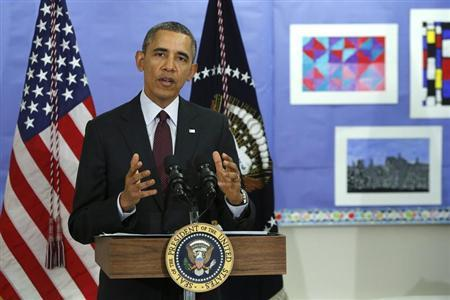 Obama answers a question about the situation in Ukraine, following remarks on the budget at Powell Elementary School in Washington