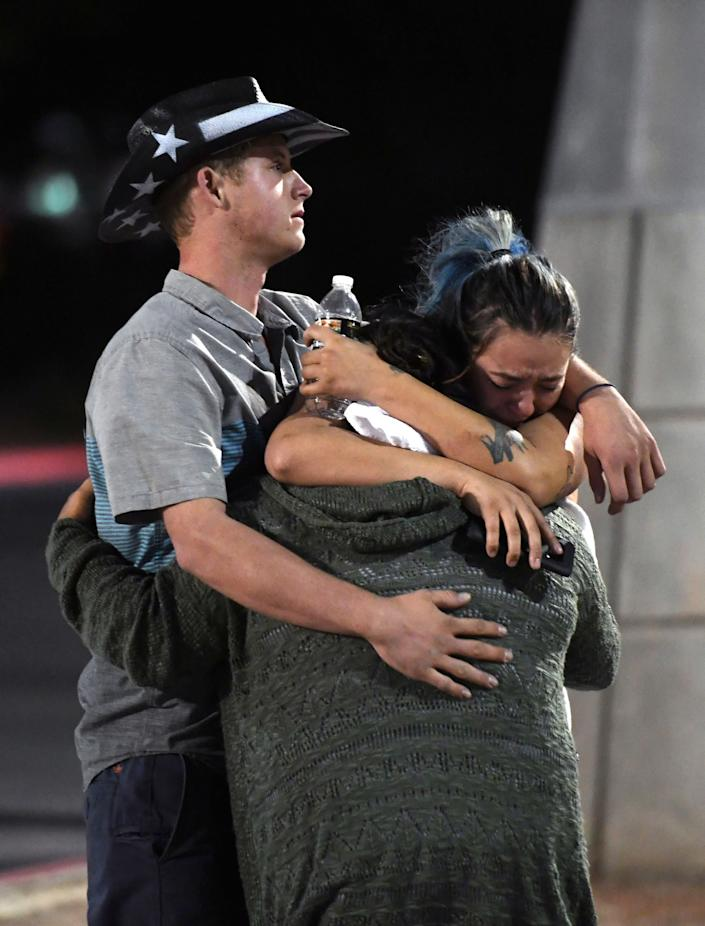People hug and cry outside the Thomas & Mack Center after a mass shooting at the Route 91 Harvest country music festival on Oct. 2, 2017, in Las Vegas.
