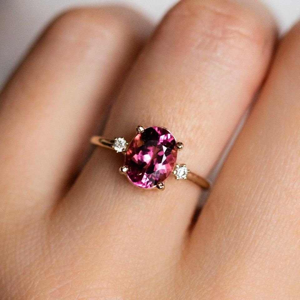 """<p>Instead of going down the traditional route, opt for a playful piece like this <a href=""""https://www.popsugar.com/buy/Oval-Pink-Tourmaline-Ring-531799?p_name=Oval%20Pink%20Tourmaline%20Ring&retailer=localeclectic.com&pid=531799&price=785&evar1=fab%3Aus&evar9=47015200&evar98=https%3A%2F%2Fwww.popsugar.com%2Ffashion%2Fphoto-gallery%2F47015200%2Fimage%2F47016006%2FOvals-Oval-Pink-Tourmaline-Ring&list1=shopping%2Cjewelry%2Crings%2Cengagement%20rings&prop13=mobile&pdata=1"""" rel=""""nofollow noopener"""" class=""""link rapid-noclick-resp"""" target=""""_blank"""" data-ylk=""""slk:Oval Pink Tourmaline Ring"""">Oval Pink Tourmaline Ring</a> ($785).</p>"""
