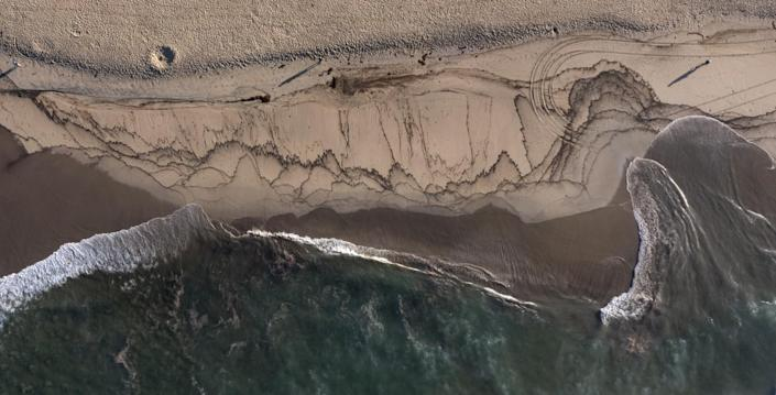 An aerial view of a major oil spill washing ashore on the border of Huntington Beach and Newport Beach.