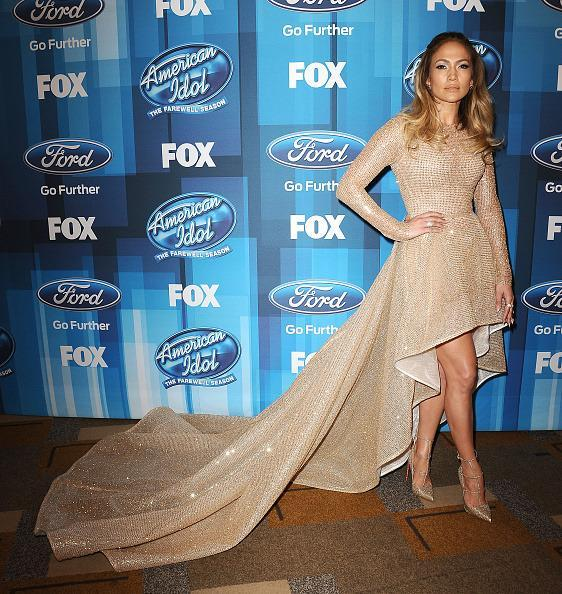<p>For the grand finale, the show's judge went all out. Wearing a gold Zuhair Murad mullet dress, the singer was totally black tie — but showed off her legs for some sexiness. <i>(Photo: Getty Images)</i></p>