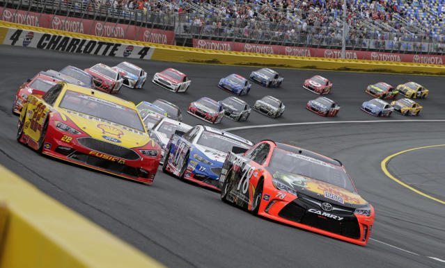 FILE - In this May 29, 2016, file photo, Martin Truex Jr (78) and Joey Logano (22) lead the field out of Turn 4 for the start of the NASCAR Sprint Cup series auto race at Charlotte Motor Speedway in Concord, N.C. The governor of North Carolina says NASCAR can go forward with the Coca-Cola 600 at Charlotte Motor Speedway at the end of May so long as health conditions do not deteriorate in the state. Gov. Roy Cooper said Tuesday, April 28, 2020, he and state public health officials have had discussions with NASCAR and the speedway regarding its safety protocols for staging a race without spectators. Cooper said the state offered input on NASCARs plan, but he believes the race can go forward on Memorial Day weekend for the 60th consecutive year. (AP Photo/Chuck Burton, File)