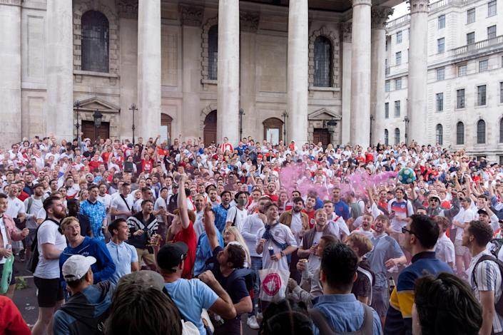 A large group of England soccer or football fans congregate outside to watch England in the Euro Cup finals.