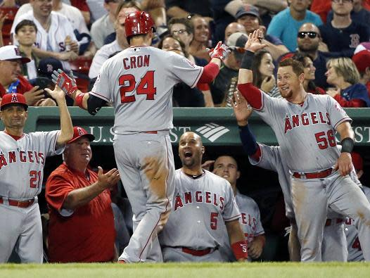 C.J. Cron of the Angels celebrates his two-run home run during the seventh inning. (AP)