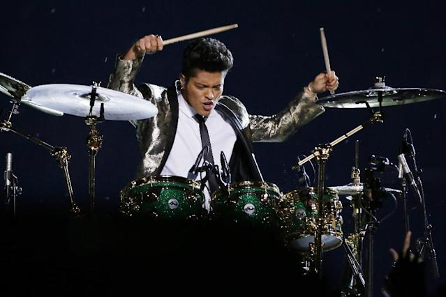 Bruno Mars performs during the halftime show of the NFL Super Bowl XLVIII football game Sunday, Feb. 2, 2014, in East Rutherford, N.J. (AP Photo/Mark Humphrey)