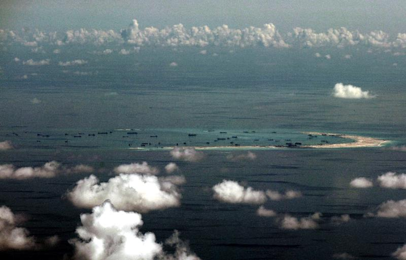 Alleged on-going reclamation by China on Mischief Reef in the disputed Spratly Islands chain in the South China Sea, pictured on May 11, 2015 (AFP Photo/Ritchie B. Tongo)