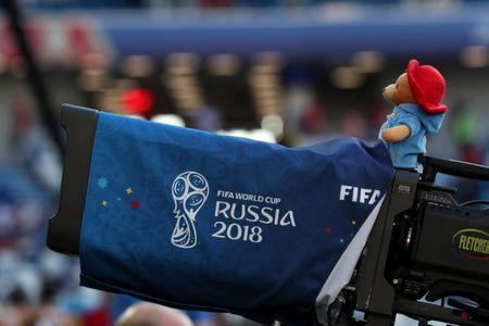 A Paddington Bear stuffed toy sits on a TV camera during the England vs Belgium match at Kaliningrad Stadium, Kaliningrad, Russia, June 28, 2018. REUTERS/Mariana Bazo