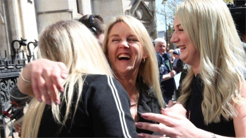 Former post office worker Janet Skinner (centre) outside the Royal Courts of Justice, London, after having her conviction overturned by the Court of Appeal