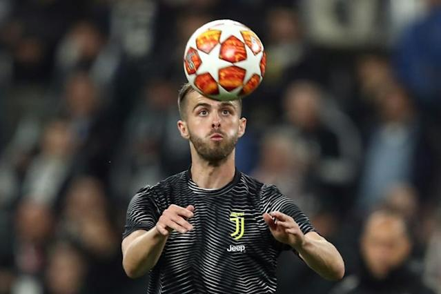 Bosnian midfielder Miralem Pjanic will move to Barcelona from Juventus at the end of the current season, with Arthur Melo heading in the opposite direction in a separate deal (AFP Photo/Isabella BONOTTO)