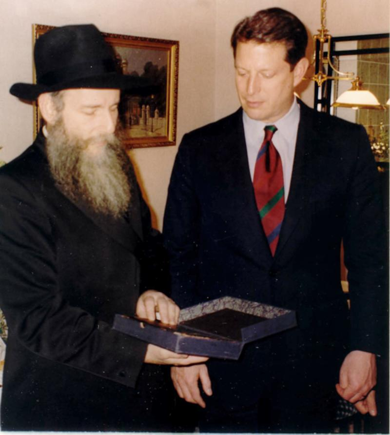 This Dec. 1993 photo provided by the Chabad-Lubavitch collection shows Vice President Al Gore presenting a book from the Schneerson Collection to Rabbi Boruch Shlomo Cunin of Chabad of California, in Moscow. The Obama administration is opposing a Jewish group's bid to levy civil fines against Russia for failing to obey a court order to return its historic books and documents _ a dispute which has halted the loan of Russian art works for exhibit in the United States.  (AP Photo/Chabad-Lubavitch collection)