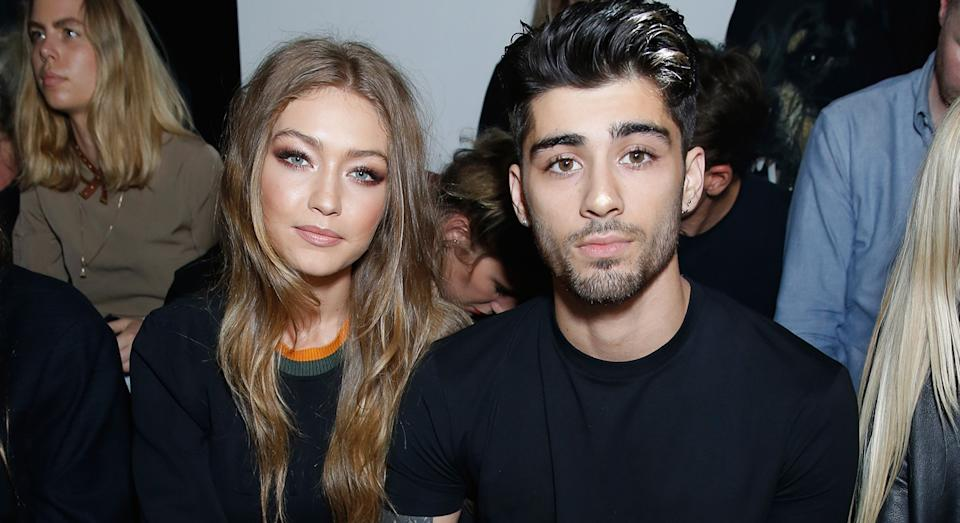 Gigi Hadid and Zayn Malik coordinate with matching evil eye bracelet. (Getty Images)