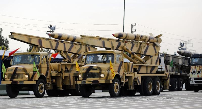 Iranian trucks carrying Zelzal missiles take part in a 2014 military parade in Tehran
