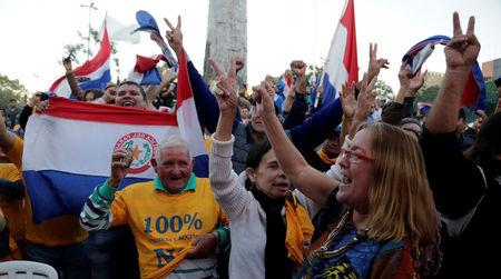 People celebrate rejection of the amendment in front of the Congress after members discuss during a session at the Lower House amendment to allow presidential second terms of Congress in Asuncion