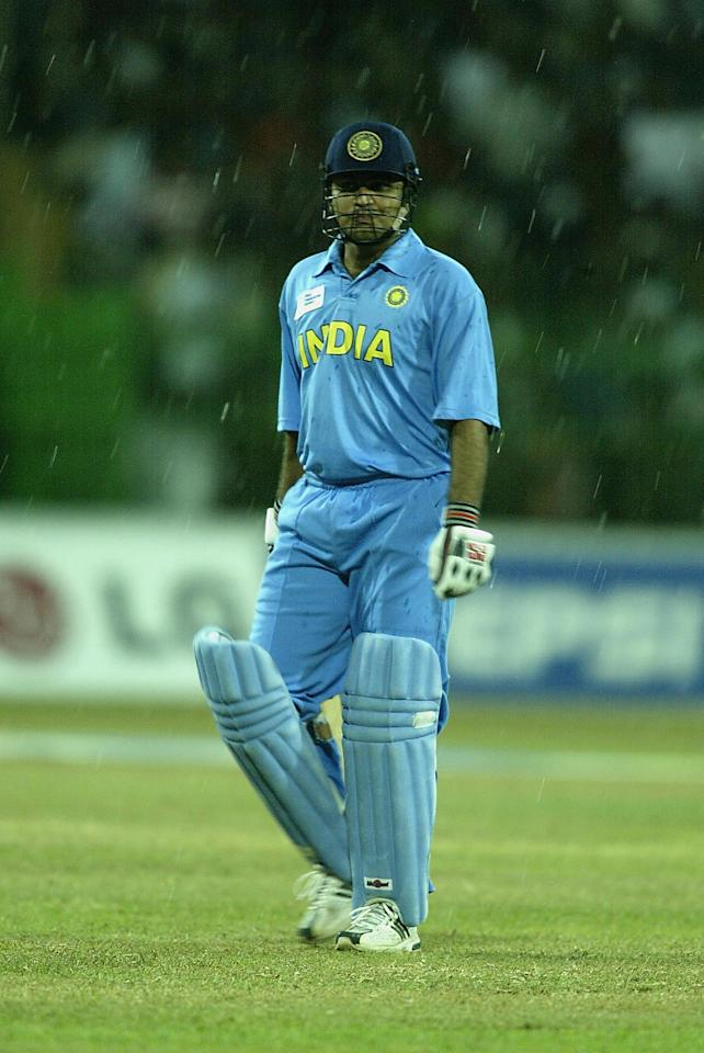 COLOMBO - SEPTEMBER 29:  Virender Sehwag of India leaves the pitch as the heavens open during the ICC Champions Trophy final between Sri Lanka and India at the Premadasa Stadium in Colombo, Sri Lanka  on September 29, 2002. (Photo by Clive Mason/Getty Images.)