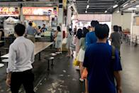 The queue for a drinks stall at the Market Street Food Centre seen on 7 April 2020, the first day of Singapore's month-long circuit breaker period. (PHOTO: Dhany Osman / Yahoo News Singapore)